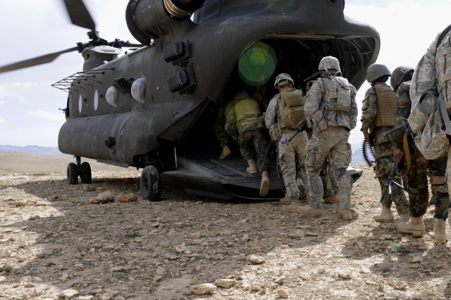 LOGAR PROVINCE, Afghanistan - After a successful mission in the village of Kwajangur, in Afghanistan's Khewer district, Soldiers from the 2nd Platoon, Troop C, 1st Squadron, 91st Cavalry Regiment, 173rd Airborne Brigade Combat Team, and 2nd Company, 1st Kandak, 4th Brigade Afghan National Army (ANA), load onto a CH-47 Chinook helicopter for the flight back to Combat Outpost Khewer.  After finding weapons during a search of the village, Troop C commander, Army Capt. Chris Shepherd, said he was happy with the actions of the ANA and the Afghan National Police.