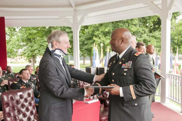 Steve Forbes, guest speaker for the 2010 USAWC graduation, congratulates Army Col. Sammie L. Hargrove after receiving his diploma at the graduation ceremony June 12, 2010.