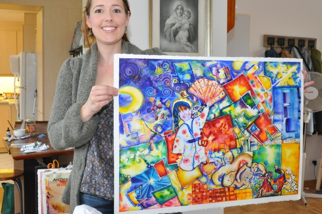 Mary Johnson show off one of her colorful artworks.