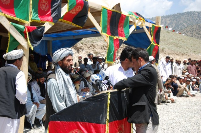 PAKTYA PROVINCE, Afghanistan - A leader from Paktya province talks with a reporter broadcasting the Voice of Peace Shura live to a radio audience.  Paktya-area leaders held the first regional peace shura in Chamkani, Paktya province, June 10, following the Afghan National Peace Consultative Jirga, June 2 in Kabul.  Afghan National Army commandos and the 23rd Corps 3-3 Kandak provided security for the historical event.