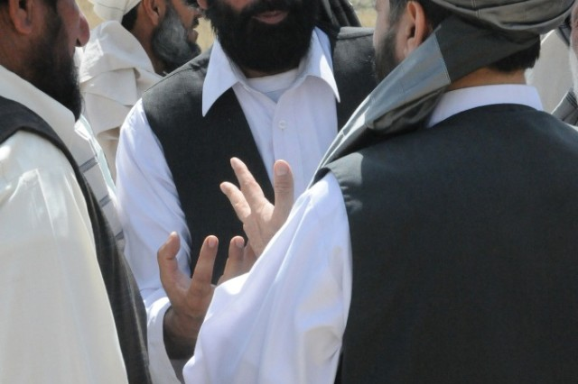 PATYA PROVINCE, Afghanistan - Matjhas Khan, a representative from the Chamkani district, discusses the Voice of Peace Shura held June 10 in Chamkani, Paktya province, with other attendees.  An estimated 2,000 attended the peace shura to listen to speakers discuss peace.