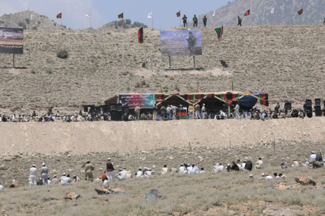 PAKTYA PROVINCE, Afghanistan - Some of the estimated 2,000 attendees of the Voice of Peace Shura listen to speakers discuss peace in Paktya province June 10, in Chamkani district.  Paktya-area leaders held the first regional peace shura in Chamkani, Paktya province, following the Afghan National Peace Consultative Jirga June 2 in Kabul.  Afghan National Army commandos and the 203rd Corps 3-3 kandak provided security for the historical event.
