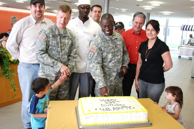 Left to right: Scott Shimon, U.S. Army Garrison Stuttgart dining facility manager; Maj. Mike Whitloch, U.S. European Command, with son Alan Whitloch; Lillian Wilkins, cook; Jeff Romero, chief of plans and operations at the USAG Stuttgart Directorate of Logistics; Sgt. 1st Class Odwin Matthews, Special Operations Command; Karl Heinz-Meuller, DOL director; Frank Mottin, USAG Stuttgart food program manager; Alexandra Villarreal, DFAC administrative assistant, and Nora Whitloch watch as Matthews cuts the cake in celebration of the U.S. Army's 235th Birthday at the Black Stallion Dining Facility on Patch Barracks June 14.