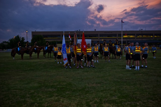 FORT HOOD, Texas - As the sun begins its morning climb, the troopers of the 1st Cavalry Division gather at Fort Hood's Cooper Field, June 14, for the 1st Cav. Div. run in celebration of the Army's 235th Birthday.