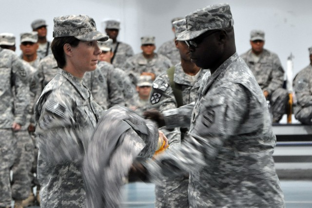 Lt. Col. Paula Lodi, the commander of the Special Troops Battalion, 15th Sustainment Brigade, and Command Sgt. Maj. Clarence Miller Jr., the battalion's senior noncommissioned officer, case the battalion's colors during a transfer of authority ceremony May 25 at Joint Base Balad, Iraq. (U.S. Army Photo by Staff Sgt. Rob Strain, 15th Sustainment Brigade Public Affairs)