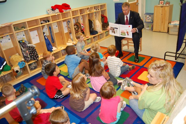 Joel Himsl, Garrison Manager, U.S. Army Garrison-Rock Island Arsenal, reads this year's version of the Army Birthday Book to children at the Arsenal's Child Development Center the morning of June 14.