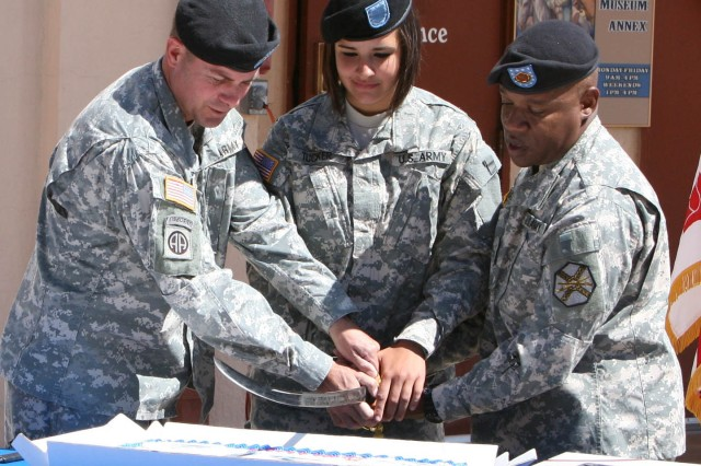 Col. Timothy Faulkner (left), garrison commander, Fort Huachuca, and Command Sgt. Maj. Mark Barbary (right), command sergeant major, Fort Huachuca, cut the Army birthday cake with Pvt. Kendyl Tucker, youngest Soldier present, during Fort Huachuca's celebration of the Army's 235th birthday.