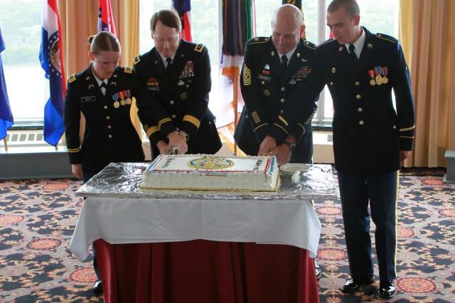 (From left) Second Lt. Amanda Bent (the youngest officer), Lt. Gen. Buster Hagenbeck (the senior officer), Command Sgt. Maj. Anthony Mahoney (the senior non-commissioned officer) and Spc. Michael Jones (youngest Soldier present) cut the Army birthday cake commemorating the 235th Army Birthday during the celebration at the West Point Club Ballroom June 14. In Army tradition, the youngest officer and enlisted Soldier take part in the cake cutting ceremony with the most senior officer and enlisted assigned to the command.