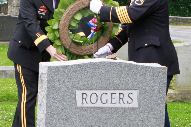 West Point 's 57th Superintendent  Lt. Gen. Buster Hagenbeck (left) and USMA Command Sgt. Maj. Anthony Mahoney (center) place a wreath in front of the grave of Gen. Bernard W. Rogers, former Army Chief of Staff, USMA Class of 1943 and West Point Commandant of Cadets from 1967-69 June 14. The wreath laying ceremony was a part of West Point's 235th Army Birthday celebration.