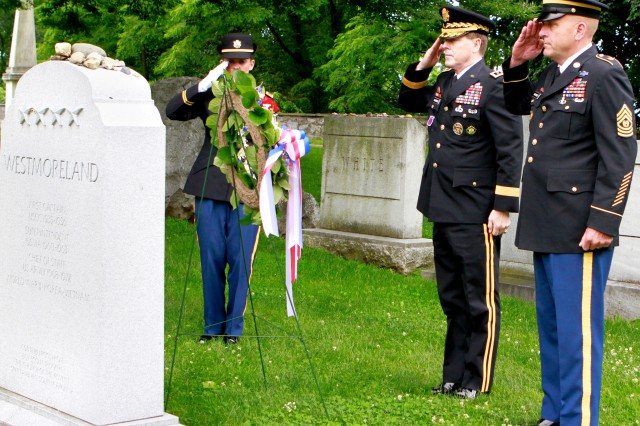 The 57th Superintendent of the U.S. Military Academy, Lt. Gen. Buster Hagenbeck, and Command Sgt. Maj. Anthony Mahoney, West Point's senior non-commissioed officer, render a hand salute after placeing a wreath at the grave of Gen. William C. Westmoreland, former Army Chief of Staff, USMA Class of 1936 and West Point Superintendent from 1960-1963 June 14. The wreath laying ceremony was a part of West Point's 235th Army Birthday celebration.
