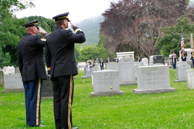 United States Military Academy Superintendent Lt. Gen. Buster Hagenbeck and Command Sgt. Maj. Anthony Mahoney, West Point's senior non-commissioned officer, render hand salutes at the conclusion of the Wreath Laying ceremony in the West Point cemetery June 14. The ceremony was a part of the 235th Army Birthday celebration held at West Point.