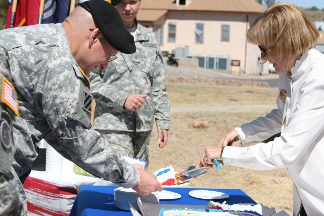 Katherine Schmidli, Fort Huachuca Museum staff member, distributes cake following the installation's celebration of the Army's 235th birthday, today. Attendees also celebrated the museum's 50th anniversary.
