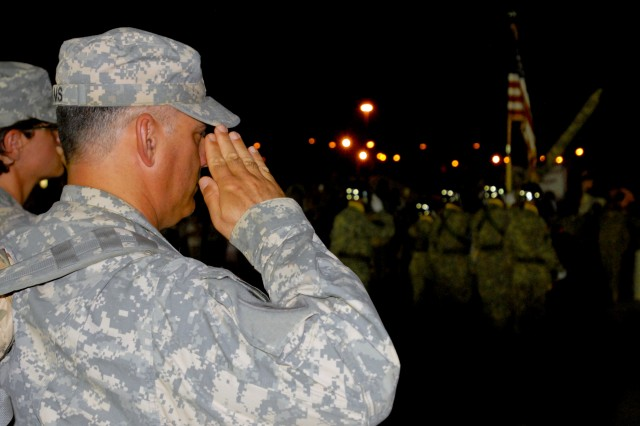 The mass formation saluted the American flag during the National Anthem before they were released to their families. The 15th Sustainment Brigade redeployed more than 200 Soldiers from Iraq May 30 at Fort Hood, Texas. (U.S. Army photo by Sgt. 1st Class Erick Ritterby)