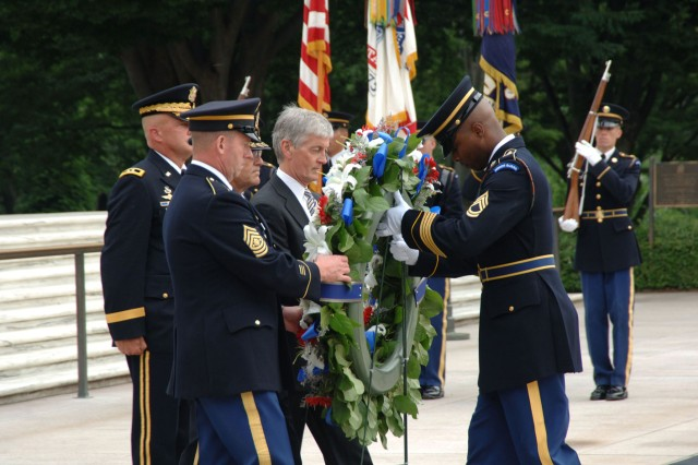 The Secretary of the Army, the Honorable John McHugh along with the Chief of Staff of the United States Army, General George W. Casey Jr. and the Sergeant Major of the Army, Kenneth O. Preston lay a wreath in honor of the U.S. Army Birthday during an Army Full Honor Wreath Ceremony at the Tomb of the Unknown Solider at Arlington National Cemetery on June 14, 2010.