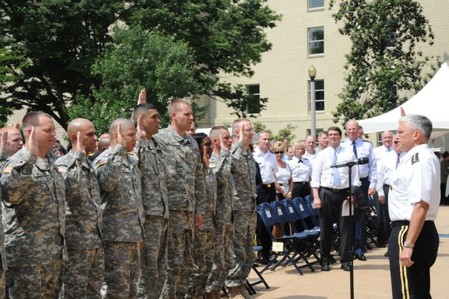 Army Chief of Staff Gen. George W. Casey Jr. administers the oath of re-enlistment to Soldiers at the Pentagon's Army Birthday celebration June 14.