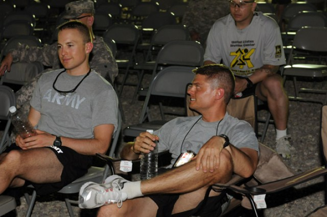 BAGHDAD - Two Soldiers relax and enjoy rock music following the Army's 235th birthday celebration June 14 at Camp Liberty.  (U.S. Army photo by Spc. Daniel Schneider, 366th MPAD, USD-C)