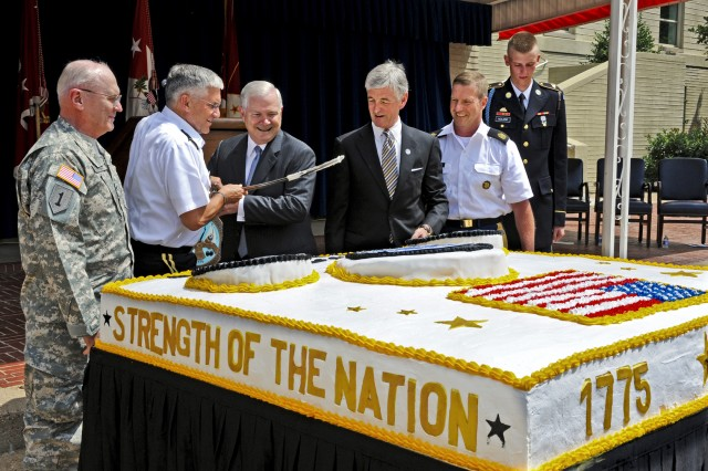 Chief of Staff Gen. George W. Casey Jr., second from left, Defense Secretary Robert M. Gates, center, Army Secretary John M. McHugh and Sgt. Maj. of the Army Kenneth O. Preston use a sword to cut the cake for the Army's 235th birthday ceremony at the Pentagon, June 14, 2010.