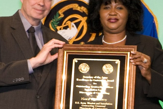 Nora Cherry, MICC, DOC, Fort Benning, Ga., received the Outstanding Contracting Officer Installation Level - Directorate of Contracting Award.