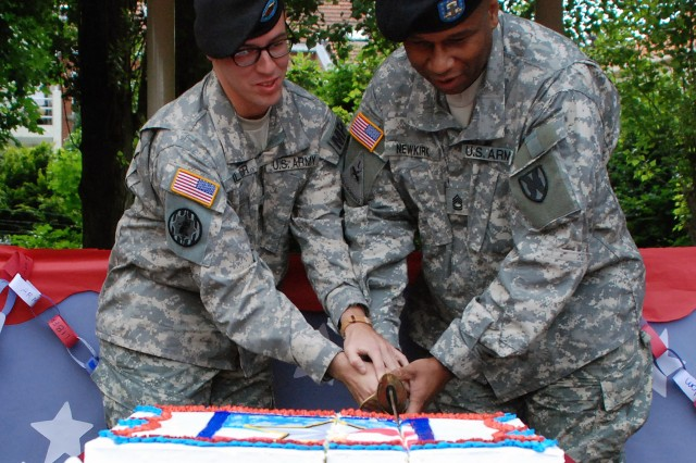 U.S. Army Garrison Brussels, Belgium celebrated the 235th birthday of the U.S. Army during a brief ceremony on June 14.   The event included the reading of messages from the Army leadership, a cake cutting and children singing a song they developed for the occasion.   Here the garrison's youngest Soldier, Spc. Justin Miller  (left) and its oldest Sgt. 1st Class Lester Newkirk cut the cake with a sabre.