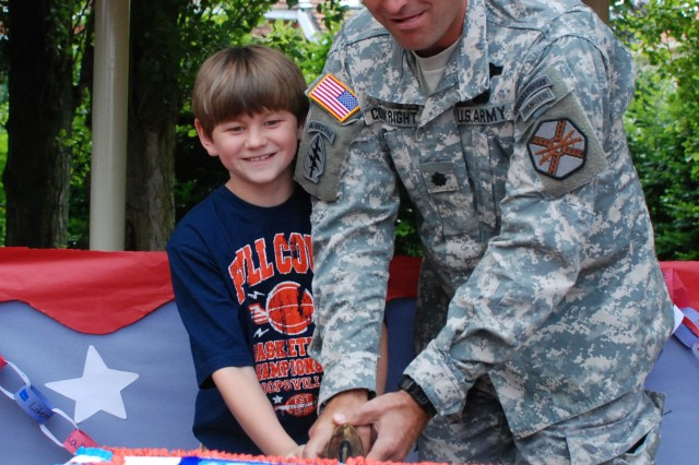 U.S. Army Garrison Brussels, Belgium celebrated the 235th birthday of the U.S. Army during a brief ceremony on June 14.   The event included the reading of messages from the Army leadership, a cake cutting and children singing a song they developed for the occasion.   Here garrison commander Lt. Col. Darin Conkright and 11-year old Dakota Henderson cut the cake.