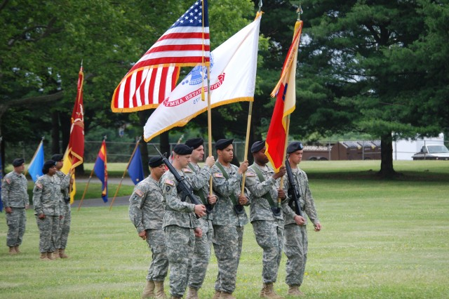 FORT DIX, N.J. – Soldiers of the 77th Sustainment Brigade participate as part of the color guard during the Assumption of Command ceremony at Sharpe Field here June 12. Command Sgt. Maj. Nagee Lunde, 77th Sustainment Brigade command sergeant major takes charge of the color guard during the ceremony. The mission of the 77th Sust. Bde. is to plan, prepare, execute and assess CSS operations within a corps or theater area of operation in order to support Joint, Inter-agency and Multinational forces as required. (U.S. Army photo by Spc. Sophia R. Lopez, 316th ESC Public Affairs Office)