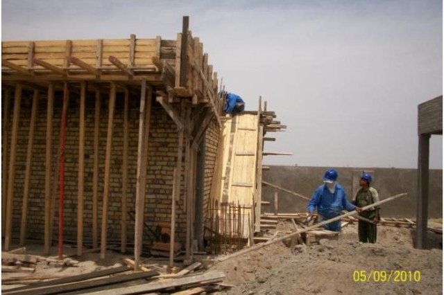Iraqis work on building the Sul Hudabiah School June 9.   Troops with Battery B, 3rd Battalion, 29th Field Artillery Regiment, 3rd Brigade Combat Team, 4th Infantry Division conduct frequent project inspections of the Commander's Emergency Response Program.