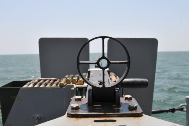 The sight of the M2 .50 caliber machine gun provides a view of the Atlantic Ocean from the deck of the Large Tug-805 the afternoon of June 11.  (U.S. Army photo Sgt. 1st Class Kelly Jo Bridgwater)