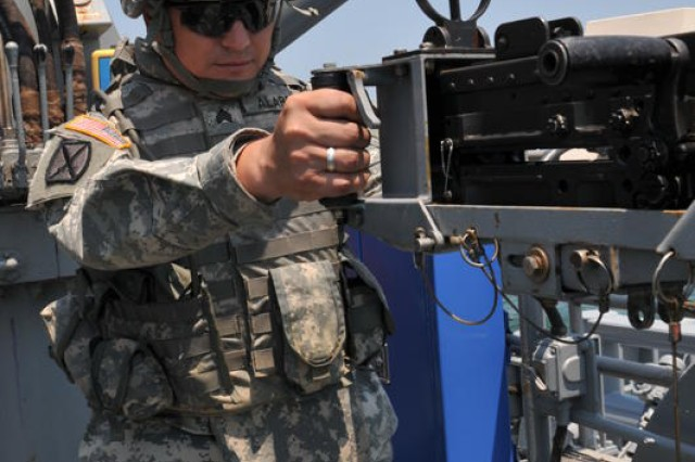 Sergeant Vargas Alarcon, a watercraft engineer with the 73rd Transportation Company, 10th Transportation Battalion, 7th Sustainment Brigade fires the M2 .50 caliber machine gun on board the Large Tug-805 in the waters off the coast of the Virginia peninsula Saturday morning. Army watercraft assigned to the 7th Sustainment Brigade conducted a waterborne gunnery June 11-13 in preparation for the annual Joint Logistics Over The Shore exercise taking place all week at Joint Expeditionary Base Little Creek-Fort Story. (U.S. Army photo by Sgt. 1st Class Kelly Jo Bridgwater)
