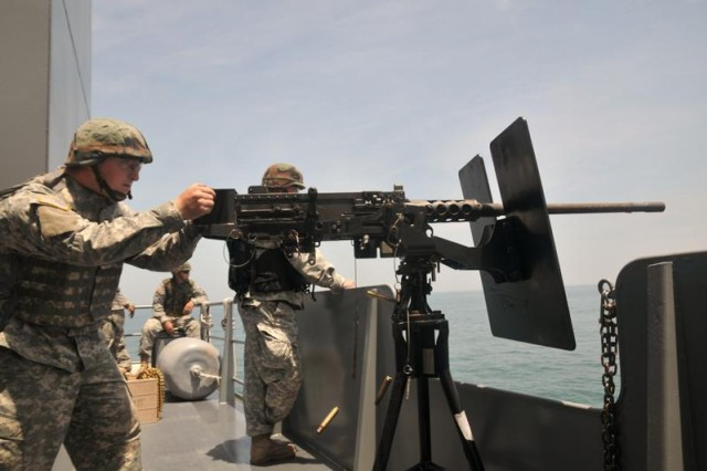 Specialist Jake Bandera, 335th Transportation Detachment, 24th Transportation Battalion fires the M2 .50 caliber machine gun June 13 from the deck of Logistic Support Vessel One, \'First and Finest' the Gen. Frank S. Besson Jr., during a three-day waterborne gunnery held off the Virginia coast for watercraft assigned to the 7th Sustainment Brigade.(U.S. Army photo Sgt. 1st Class Kelly Jo Bridgwater)