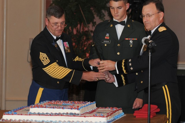 HONOLULU, Hawaii- Lt. Gen. Benjamin R. Mixon, commanding general, U.S. Army-Pacific, Command Sgt. Maj. Joseph Zettlemoyer, command sergeant major, USARPAC,  and Pfc. Daryl Tippens, intelligence analyst, 8th Military Police Brigade, 8th Theater Sustainment Command, cut the Army Birthday Cake during the 235th Army Birthday Commemoration, at the Hilton Hawaiian Village, here, June 12.