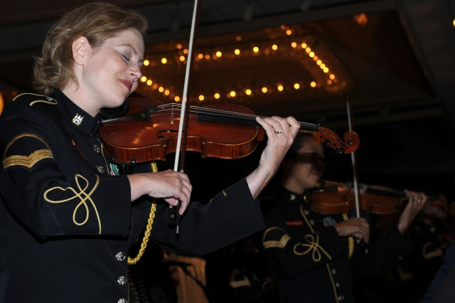 HONOLULU, Hawaii-Soldiers of the The U.S. Army Band Strolling Strings musical ensemble, from Washington D.C., entertain the audience at the 235th Army Birthday Commemoration, at the Hilton Hawaiian Village, here, June 12.