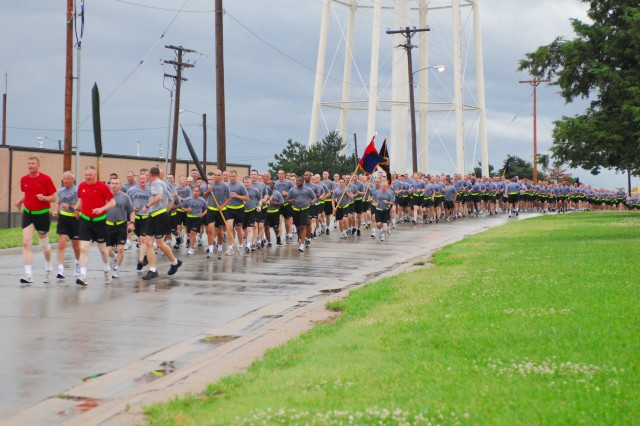"Brig. Gen. David Petersen, 1st Infantry Division and Fort Riley deputy commanding general - rear, and Command Sgt. Major Darrel Wallace, division command sergeant major - rear, lead more than 5,000 Soldiers of the 1st Infantry Division, June 15 at the beginning of the four-mile Victory Run. The run is the initial kick-off of Victory Week, a weeklong celebration in recognition of the ""Big Red One."" (Photo by Stephanie Hoff, 1st Inf. Div. Public Affairs)"