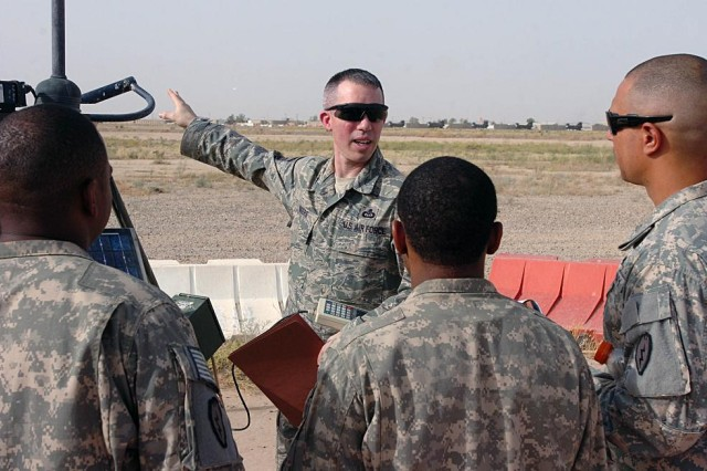 Air Force Master Sergeant Paul Rogers, weather forecaster and staff weather team noncommissioned officer in charge, 22nd Expeditionary Weather Squadron, supporting TF Wings, teaches Soldiers how to perform certain field weather checks and observations during Forward Area Limited Observer Program training at Contingency Operating Base Speicher, near Tikrit, Iraq, June 5. (Photo by: Staff Sgt. Mike Alberts, 25th Combat Aviation Brigade Public Affairs)