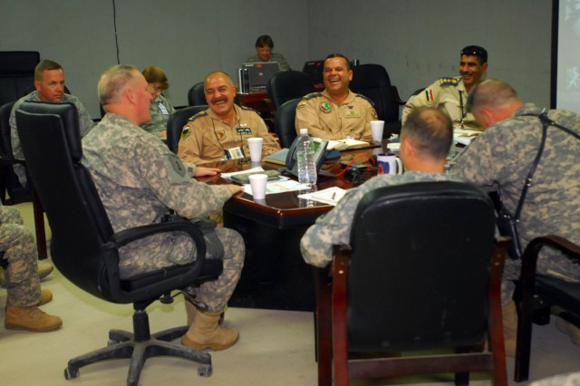 Brig. Gen. Ricky Gibbs, the Deputy Commanding General for Maneuver, 1st Infantry Division, speaks with several key members of the 70th Squadron, Iraqi Air Force, senior leaders with the Air Force 407th Air Expeditionary Group, and leaders from the 12th Combat Aviation Brigade, Task Force 12, June 2 at Contingency Operating Base Adder, Iraq, about the ongoing plans to transfer the 70th Sqdn. from Basra to Ali Air Base.