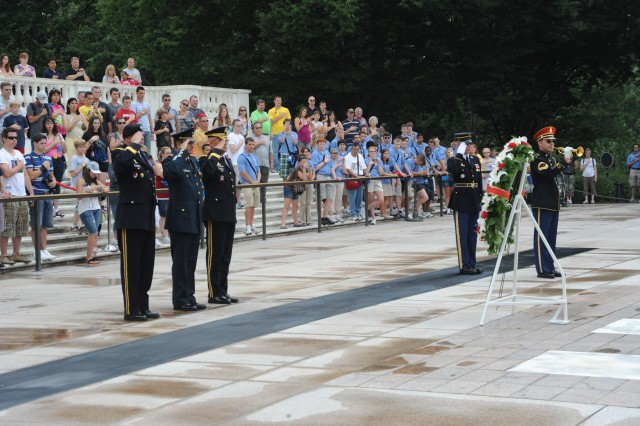 Left to right Lt. Gen. Guy Swan, III, commanding general of U.S. Army North, Maj. Gen. Alfonso Duarte, commander of 2D Military Zone, Mexico and Maj. Gen. Karl R. Horst, commanding general, Joint Force Headquarters National Capital and The U.S. Army Military District of Washington render honors during the wreath laying ceremony at Arlington Cemetery on June 15, 2010.