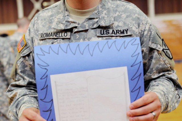 "PRESIDIO OF MONTEREY, Calif. - Spc. Michael Romanello, Co. E, 229th Military Intelligence Battalion, holds a letter from a Miami high schooler. ""These letters just make our day,"" said Romanello, who is also a native of Orlando, Fla. ""They make the worst day feel so much better."""
