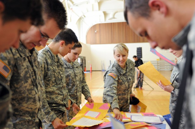 PRESIDIO OF MONTEREY, Calif. - Presidio of Monterey Soldiers look through the letters and artwork sent from Miami high-school students. The students, who are taking English as a second language, wrote in English, Creole, French and Spanish to the students knowing that some Soldiers are attending the Defense Language Institute to learn a second languages.