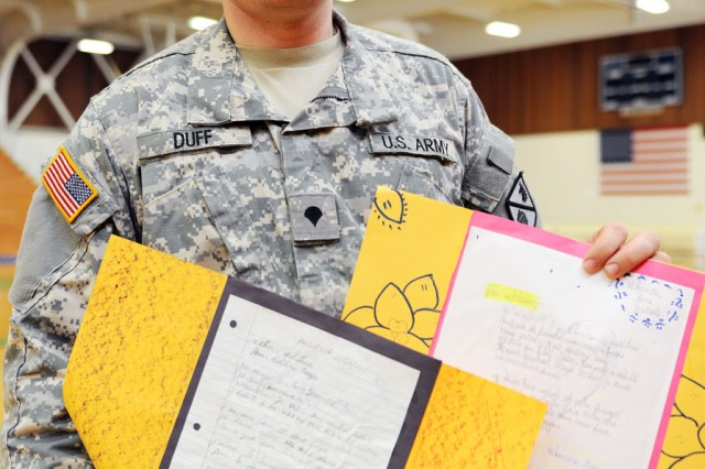 "PRESIDIO OF MONTEREY, Calif. - Spc. John Duff, Co. A, 229th Military Intelligence Battalion, displays two of his favorite letters from Miami high-school students. ""It's nice to know that people remember us from time to time,"" Duff said. Duff also had a message for the students who were learning English as a second language. ""The limits of my language are the limits of my world,"" Duff repeated from an old adage. ""So keep up your hard work."""