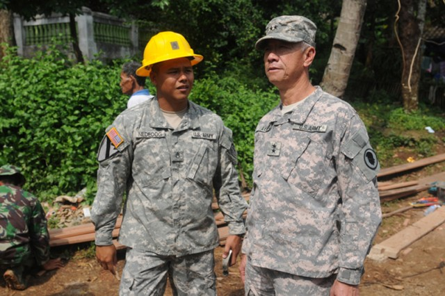 BANDUNG, Indonesia - Maj. Gen. Robert Lee, adjutant general of the Hawaii National Guard, discusses the progress of humanitarian civic action projects here June 10 with Staff Sgt. Jonathan Nededog of the 797th Engineering Company, 411th Engineering Battalion, 9th Mission Support Command.  The HCA projects are part of Operation Garuda Shield 2010, a seven-nation humanitarian and training exercise here, which is set to be complete June 21.