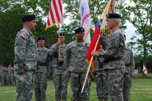 (Left) FORT DIX, N.J. - Army Brig. Gen. Peter Lennon (right), commander of the 316th Expeditionary Sustainment Command, prepares to pass the brigade flag to Col. Stephen Falcone (left), after receiving it from Command Sgt. Maj. Nagee Lunde (center), during the Assumption of Command ceremony at Sharpe Field  June 12. Falcone assumes command of the 77th Sustainment Brigade and is joined by Lunde, the new command sergeant major for this brigade. (U.S. Army photo by Spc. Sophia R. Lopez, 316th ESC Public Affairs Office)