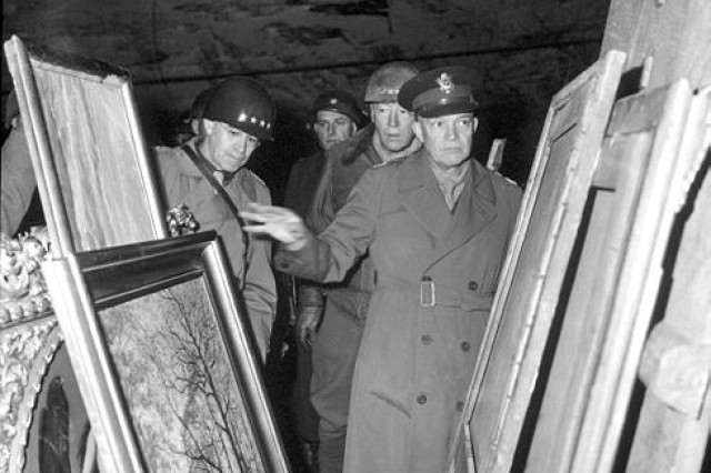 A General's View: General Dwight D. Eisenhower, Supreme Allied Commander, accompanied by Gen. Omar N. Bradley, and Lt. Gen. George S. Patton, Jr., inspect art treasures stolen by Germans and hidden in salt mine in Germany.  United States Army Signal Corps Image #204516, National Archives War & Conflict Book #: 1099.
