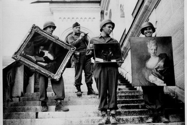 Bavarian Mission: At Schloss Neuschwanstein in southern Bavaria, Captain James Rorimer, who later would become the director of the Metropolitan Museum of Art, supervises the safeguarding of art stolen from French Jews and stored during the war at the castle (April-May, 1945). United States Army Signal Corps Image.