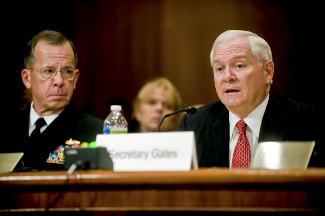 Defense Secretary Robert M. Gates testifies before the Senate Appropriations Committee with Navy Adm. Mike Mullen, chairman of the Joint Chiefs of Staff, looking on in the Dirksen Senate Office Building, in Washington, D.C., June 16, 2010.