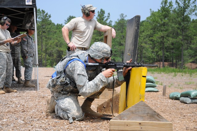 Staff Sgt. Zachary Tooman takes aim during a timed advanced combat shoot portion of the competition at Aachen Range.