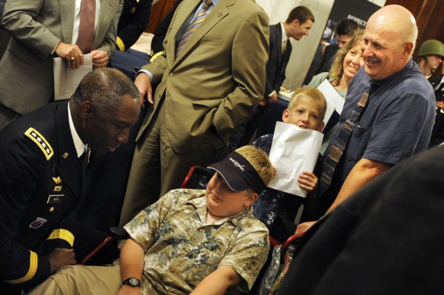"Gen. William ""Kip"" Ward, commander of U.S. Africa Command, talks with Make-A-Wish foundation participant Joshua Bluont during the Army's 235th birthday ceremony on Capitol Hill in Washington, D.C., June 15, 2010. Joshua is visiting D.C. as part of his wish which was granted by the Make-A-Wish foundation."