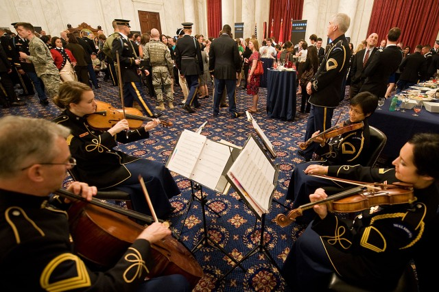 "Soldiers with the Army Band ""Pershing's Own"" perform during the Army's 235th birthday ceremony on Capitol Hill in Washington, D.C., June 15, 2010."