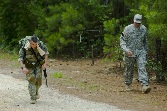 "Sgt. Adam Kourelis from the 422 Civil Affairs Battalion is the first to cross the finish line during the 10-K ""Ruck-march"" on June 16 at Fort Bragg, N.C. The U.S. Army Civil Affairs and Psychological Operations (Airborne)'s annual Best Warrior Competition is being hosted here from 14 through 18 June. Kourelis is competing against 13 other Soldiers and Noncommissioned officers from across the nation to try to take home this year's Best Warrior of the Year NCO category. The command is comprised of nearly 12,000 Soldiers in 67 units across 31 states and Puerto Rico."