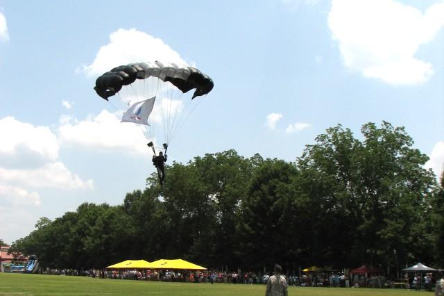Silver Wings member Sgt. Sean OAca,!a,,cToole follows Warner down carrying the U.S. Army flag.