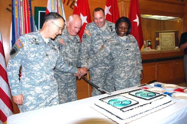 The First Army Commander, Lt. Gen. Thomas G. Miller (second from left), and command sergeant major, Command Sgt. Maj. Ronald T. Riling (third from left), are flanked by First Army Headquarters' oldest Soldier, Chap. (Col.) James DeCamp (left), Reserve component training integrator chaplain, and its youngest Soldier, Spc. Tifani Hightower (right), mail room clerk, during the unit's Army birthday celebration held June 14 at Fort Gillem.