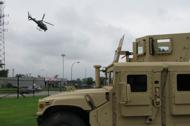 An Oakland County Sheriff Department helicopter departs the Detroit Arsenal for Lansing, MI, with a contaminated hazardous material detection filter during the Vigilant Guard exercise.